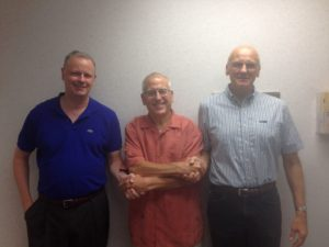 Photo of Dr. Lawrence Juvet, Dr. Richard Wolfert, DMD and Bob Achorn of Achorn Dental Lab
